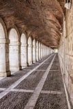Arches and passageway at the Palacio Real Aranjuez, Spain. Aranjuez, Spain - October 16, 2016: Arches and passageway at the Palacio Real Aranjuez, located in the Stock Photos