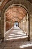 Arches and passageway at the Palacio Real Aranjuez, Spain. Aranjuez, Spain - October 16, 2016: Arches and passageway at the Palacio Real Aranjuez, located in the Stock Photo