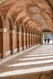 Arches and passageway at the Palacio Real Aranjuez, Spain. Aranjuez, Spain - October 16, 2016: Arches and passageway at the Palacio Real Aranjuez, located in the Stock Photography