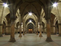 Arches and pillars at Glasgow University building. Arches and pillars at the ground floor of the Glasgow University building stock photos