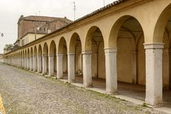 Santa Maria covered walkway on Mazzini street, Comacchio, Italy. Arches and pillars of very long Baroque santa Maria covered walkway on Mazzini street, shot at Royalty Free Stock Photos