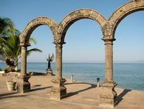 The arches of Puerto Vallarta, Mexico. With the Angel in background royalty free stock photos