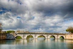 Arches of the Roman bridge Stock Images
