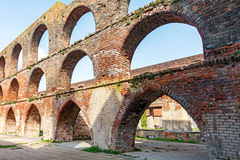 Arches in a ruin of a monastery building of red brick,  Northern Royalty Free Stock Photos