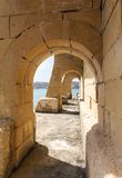 Arches on seafront Kalkara Stock Images