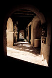 Arches and Shadows. Shadow and light accent the hallway of arches stock image