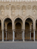 Arches surrounding the courtyard of a historic mosque, Egypt. Arches surrounding the courtyard of a historic mosque, Cairo, Egypt, built in 1421 Royalty Free Stock Photography