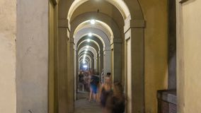 Arches of the Vasari Corridor night timelapse in Florence, Italy. The Vasari Corridor is the famous passageway which connects the Palazzo Vecchio with the stock video