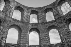 Arches. A view looking up at arches which are part of the ruins of a Roman bath located in Trier, Germany stock image