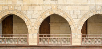 Arches with wooden balustrades, caravanserai Wikala of al-Ghur. Front view of three arches with interleaved wooden balustrades at the arcade surrounding the Royalty Free Stock Photos