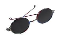 Archi incorniciati scuri degli occhiali da sole della bambola piegati Immagini Stock Libere da Diritti