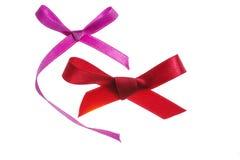 Archi rossi e porpora del regalo Fotografia Stock