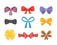 Archi svegli del regalo del fumetto con i nastri legame di farfalla di colore Fotografie Stock
