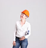 Archictress in Safety Helmet is Holding a Building Plans. Blondie Architectures is Holding Architectural Plans Isolated on White Background Stock Photography