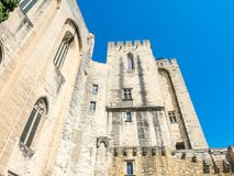 Archiecture of Papal palace in Avignon. Exterior design architecture of Papal palace Palais des papes under clear blue sky in Avignon, France royalty free stock photography