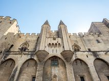 Archiecture of Papal palace in Avignon. Exterior design architecture of Papal palace Palais des papes under clear blue sky in Avignon, France stock photography