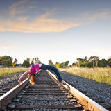 Arching Back over Railroad tracks Stock Photo