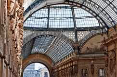 The arching glass and cast iron roof of Galleria Vittorio Emanuele II in Milan, Italy. Built in 1875 this gallery is one of the most popular landmarks and stock photos