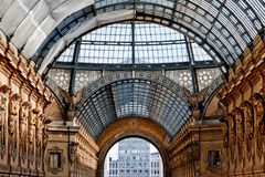 The arching glass and cast iron roof of Galleria Vittorio Emanuele II in Milan, Italy. Built in 1875 this gallery is one of the most popular landmarks and royalty free stock photos