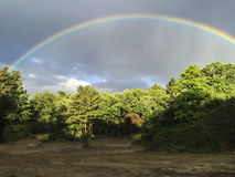 Arching rainbow. Picture of an arching rainbow stock photography