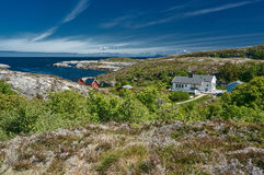Archipelag view with white and red wooden hytte. Region Trondelag island Hitra, Froya, Fosen. Stock Images