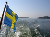 Archipelago flag and waves Royalty Free Stock Photo