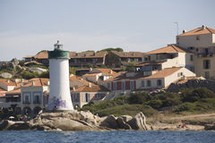 Archipelago of La Maddalena, Sardinia. Houses and lighthouse on the rocks of one of the islands of La Maddalena Royalty Free Stock Photography