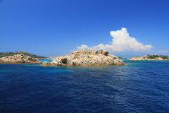 Archipelago of La Maddalena, Sardinia. Summer sea view of  Mediterranean coastline. The landscape with rocky shore and clouds over the sea in the sunny day. The Royalty Free Stock Photography