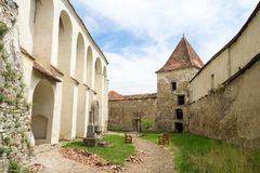 Archita medieval double-walled fortified church, Transylvania, Romania. Archita medieval church courtyard protected by fortified double walls and protection Stock Image