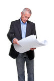 Architect. Male architect holding a set of building plans, isolated on a white background stock photo