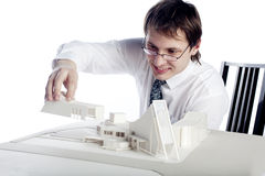 Architect. Young architect making arcitectural model Royalty Free Stock Photography