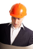 Architect. One architect wearing hardhats looking to the blueprint Royalty Free Stock Image