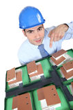 Architect. Pointing at model housing Stock Image