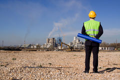 Architect. Young architect in front of industrial construction site Stock Photo