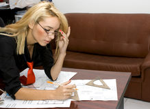 Architect. Beautiful architect designing in her office Royalty Free Stock Image