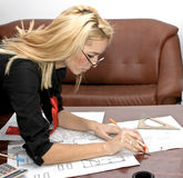 Architect. Beautiful architect designing in her office Royalty Free Stock Images