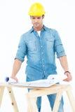Architect analyzing blueprint at table Stock Photography