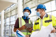 Free Architect And Engineer Discussing On Construction Site With Plan Stock Image - 213953241