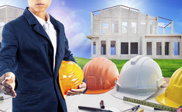 Architect with architecture working table and home construction Stock Photo