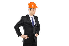 An architect in a black suit standing Royalty Free Stock Image