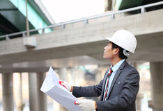 Architect   with blueprint. Architect  with blueprint on highway construction site Stock Photo