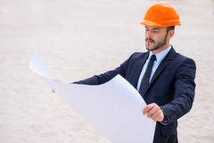 Architect with blueprint. Stock Images