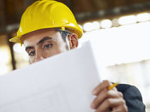 Architect with blueprint in construction site Royalty Free Stock Photo