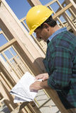 Architect With Blueprint At Construction Site Stock Photo