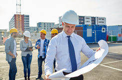 Architect with blueprint on construction site Royalty Free Stock Images