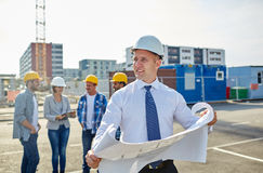 Architect with blueprint on construction site Stock Photos