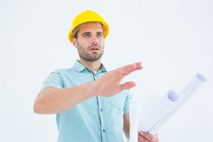 Architect with blueprint gesturing on white background Stock Image