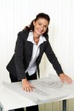 Architect with blueprint in the office. stock photos