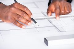 Architect with blueprint in office Royalty Free Stock Images