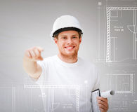 Architect with blueprint pointing at you Stock Photography